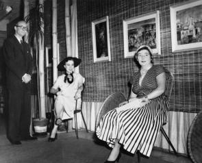 Black and white photo of DAVENPORT, Arthur. Brian and Marjorie Johnstone with Margaret Olley at The Johnstone Gallery in the basement of the Brisbane Arcade.