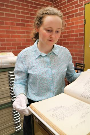 Anna Gregory with the Veness Letter Book at Tamworth Powerstation Museum