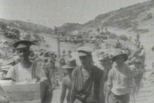 "Men of the Australian forces make their way up ""Monash Valley"", past the headquarters of Generals Monash and Chauvel."