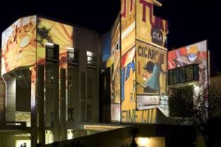 The National Gallery of Australia with works from the collection projected on the outer walls for its 25th anniversary in 2007